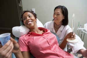 Woman-with-dentist-in-surgery