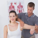 physical therapist with patient