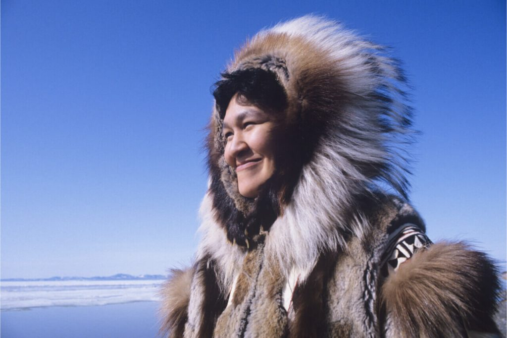 The Inuit wearing animal skin as their coat.