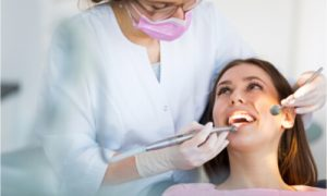 The dentist checks the patient's oral health after dental trauma.